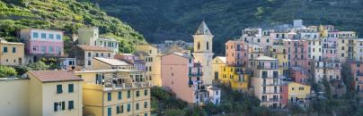 colored houses in small city in Italy