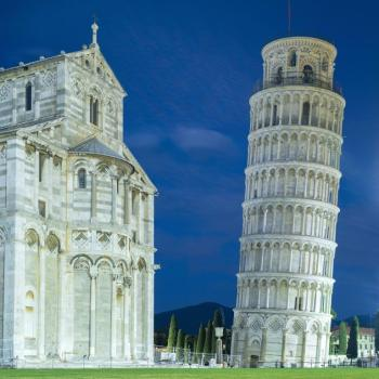 front of cathedral and falling tower in twilight light in Pisa in Italy