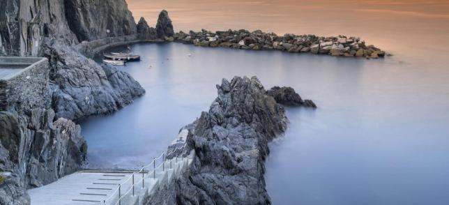 stone berth and sea in the morning in Italy