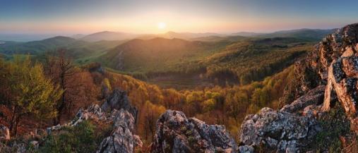 Sunset mountain panorama with sun